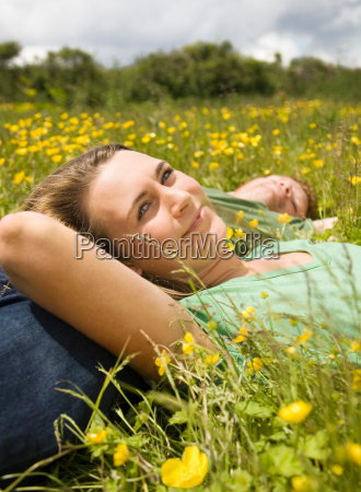 couple lying in meadow