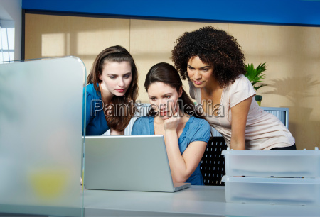 group of young women with laptop