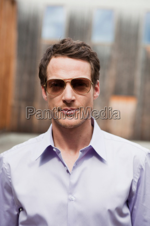 man with sunglasses looking at viewer