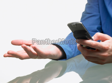 hands of a woman holding cellular