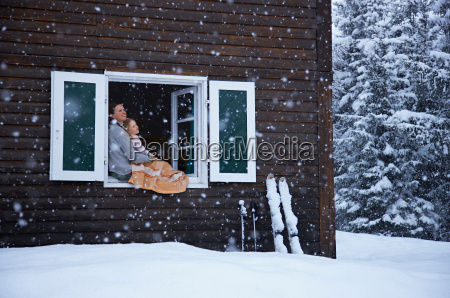 mother and daughter sitting in window