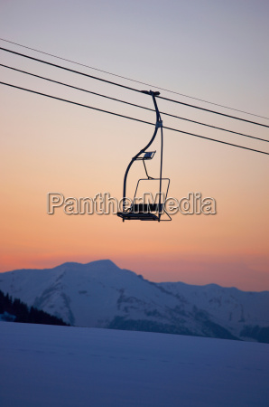 mountain view at dusk with chair