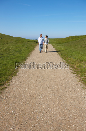 mature couple walking together