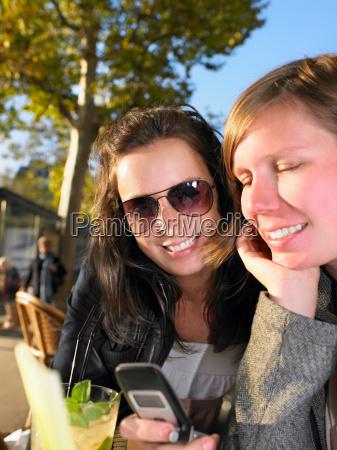 women on terrace of cafe