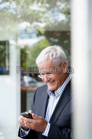 senior businessman using cellphone