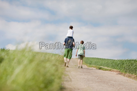 family of three walking up the