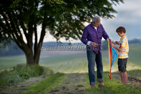 father and son building kite