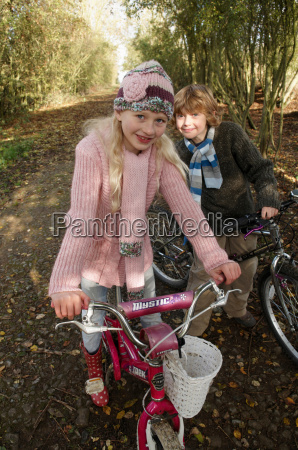 girl and boy on bikes on