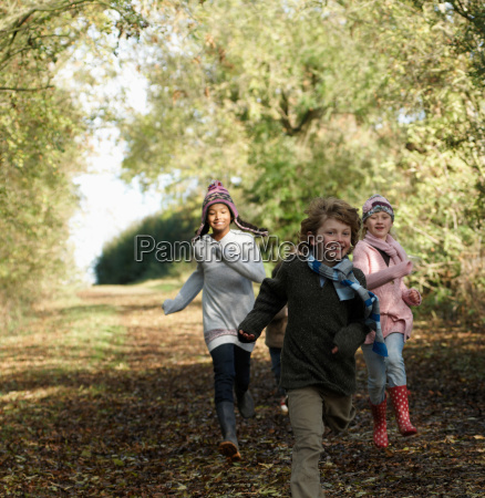 children running down country lane