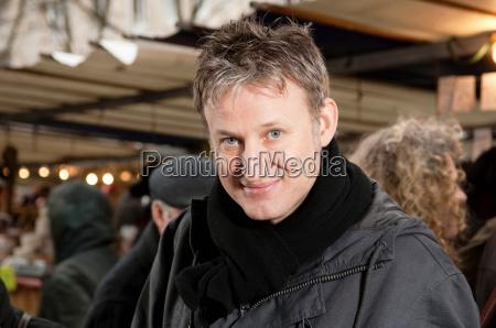 portrait of man at street market