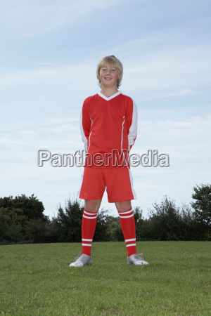 young male footballer standing