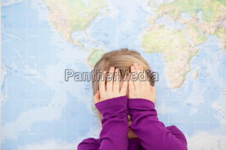 young girl hiding face with hands