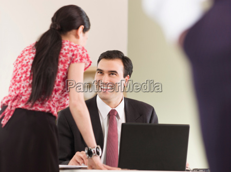 a business man talking to a