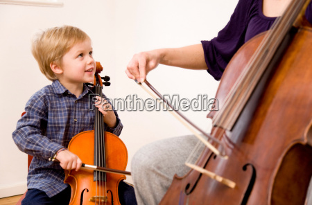 woman and boy playing cello