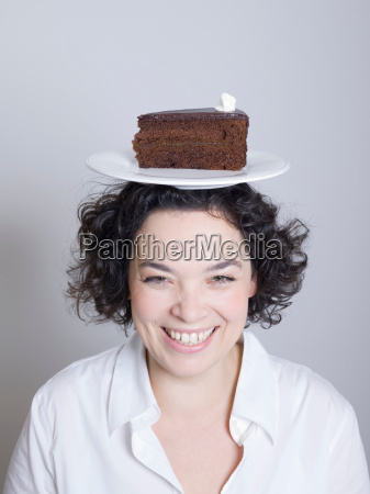 woman with a plate of cake