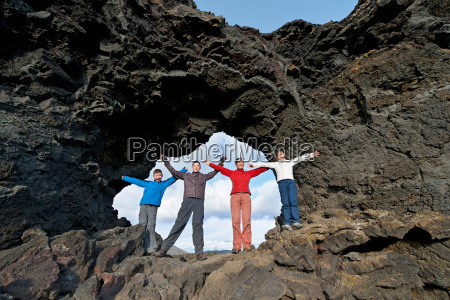 family standing on rock formation