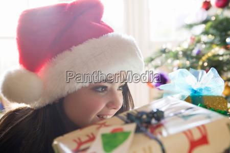 girl 14 looking at christmas present