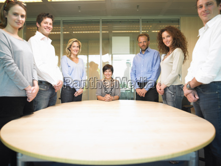people around a table smiling