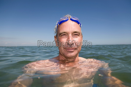 mature man swimming
