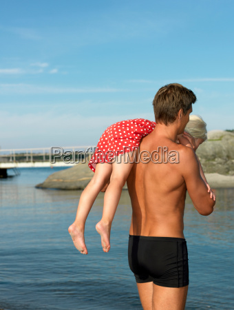 father and daughter by the water