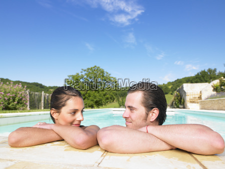 young man and woman in pool