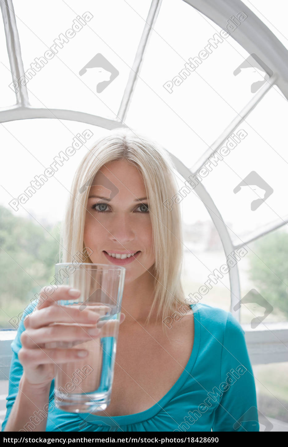 woman, holding, a, glass, of, water. - 18428690