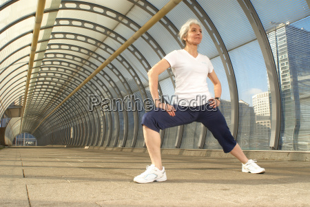 woman stretching in tunnel