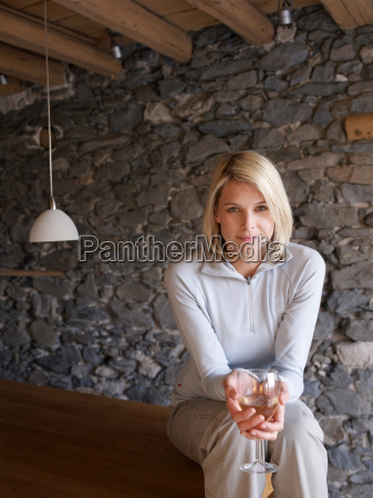 woman smiling at viewer drinking