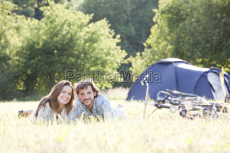 couple laying in grass in country