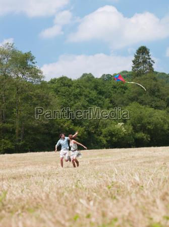 couple flying kite