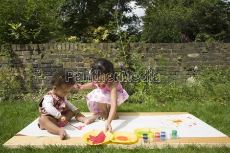 children painting in the garden