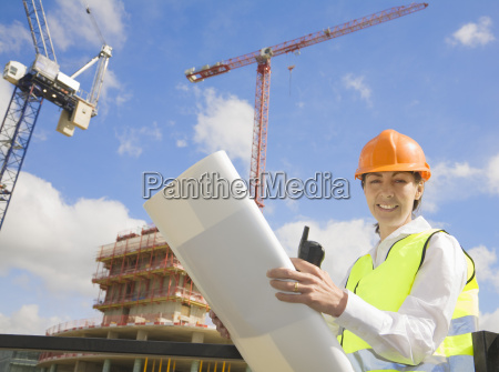 woman surveying at building site
