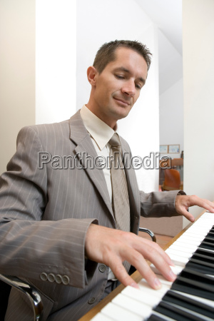 businessman playing piano