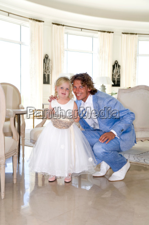 father groom with daughter flower girl