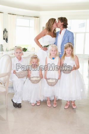 wedding couple kiss with kids
