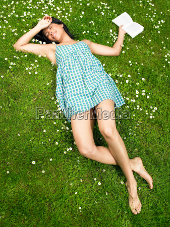 woman reading a book in the