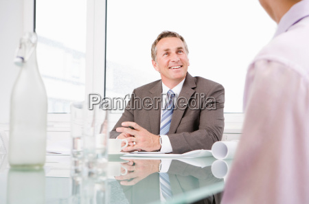 businessman talking to a colleague