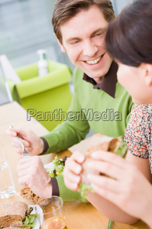 man and woman eating health food