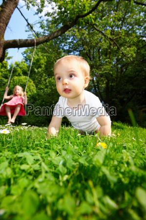baby in the garden girl on