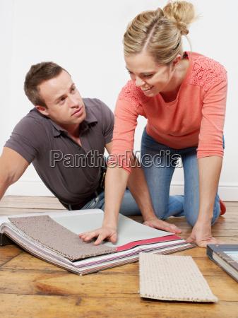 couple choosing carpet samples