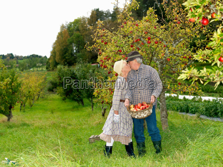 mature couple kissing in garden