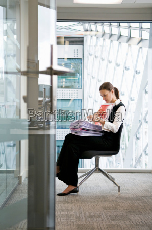 a business woman looking through files
