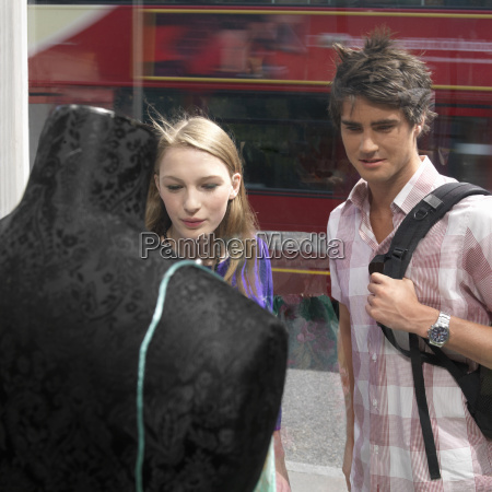 young couple looking shop window