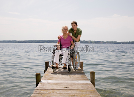 woman and senior woman in wheelchair