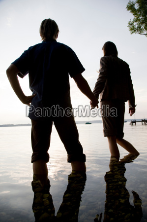 woman and man standing in lake