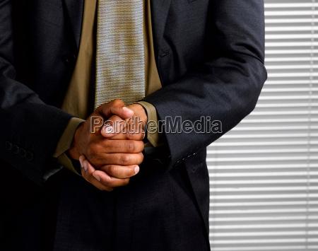 business man wringing hands together