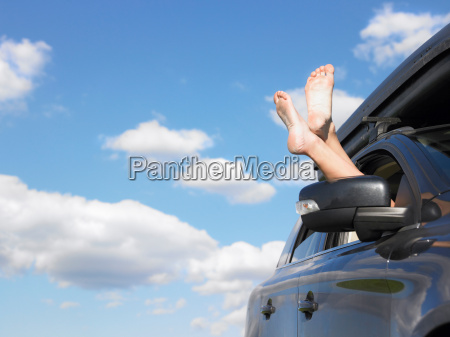 feet out of car window