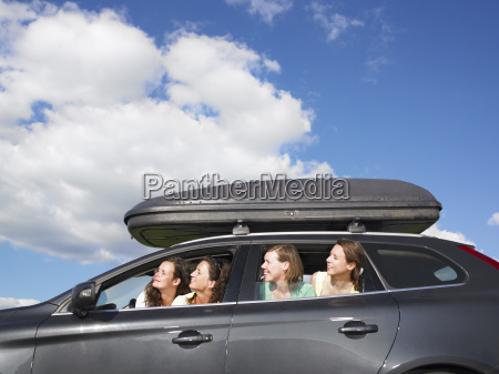 girls looking out of car windows