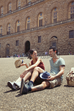 couple relaxing palazzo pitti florence tuscany