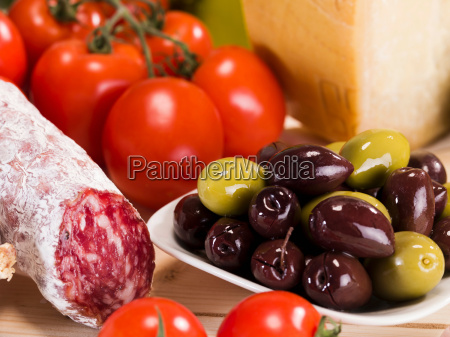 close up of salami olives and